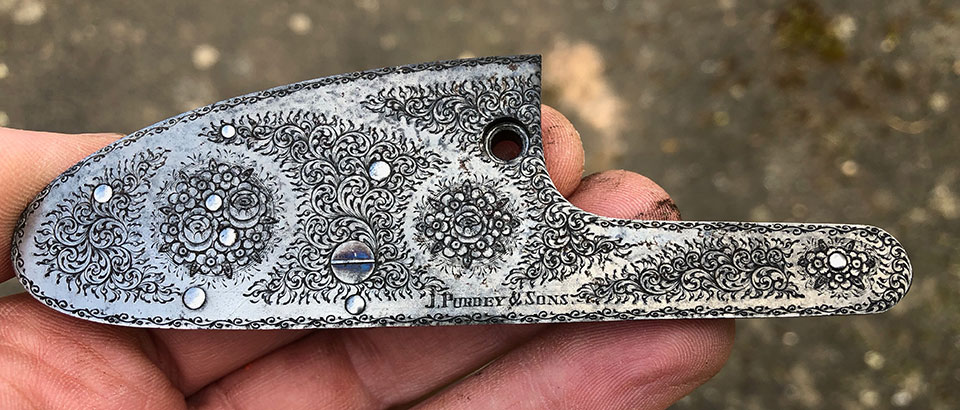 Purdey rose & scroll engraving adorns the lock plates.