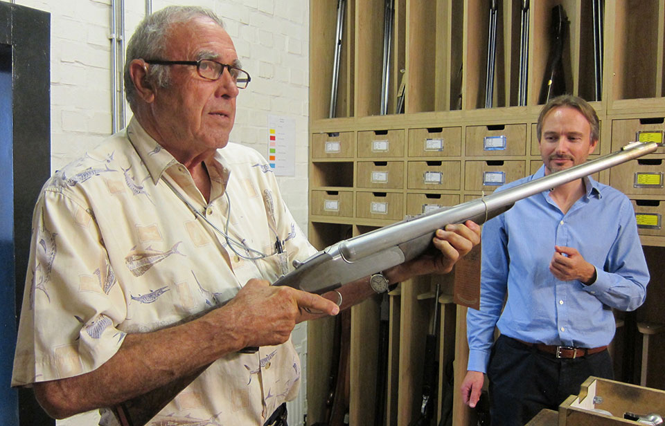 M.D 'Trigger' looks on while Cecil Mills checks a new-build sidelock double rifle.