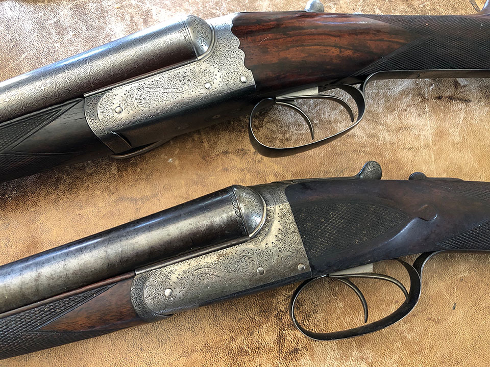 The older gun has a plain action back, while the younger one has a 'fancy back'.