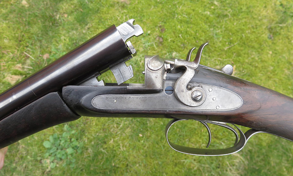 Later guns added the 1863 patent Purdey double under-bolt, making the bolted doll's head a third grip.