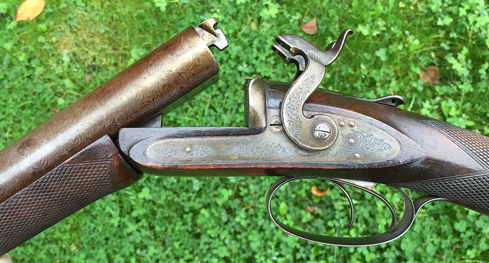Early Westley Richards breech-loaders, like this pinfire, had the bolted dolls-head as the sole means by which the barrels were secured to the action. This one is a very unusual, early version, with a slide-back top lever.