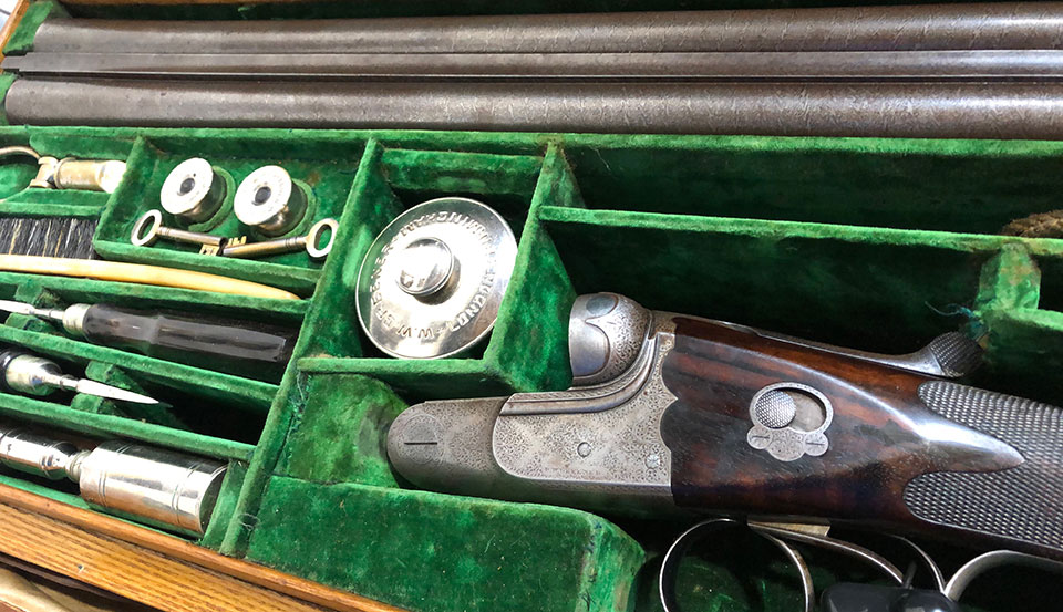 A beautifully cased gun with full set of accessories excites many collectors.