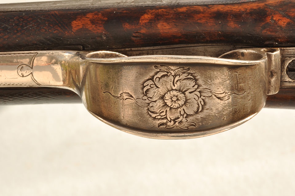 A rose engraved on the silver trigger guard, this on a weapon of war !