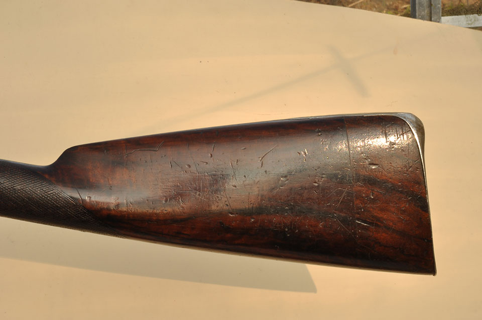 The stock on this gun displays the skill of its maker , using a wider shorter heelplate and achieving an gracefull shape, notice too the lengthened wood with the original cut off piece.