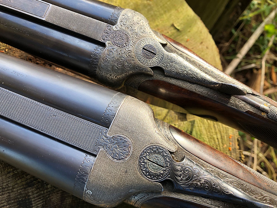 The .475 has a stippled fence pattern to reduce glare, while the .303 is more traditionally engraved.